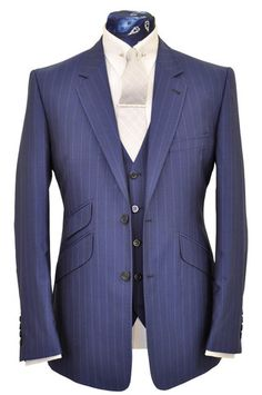 Cobalt Blue 3 Piece Suit A one button single breasted double vented suit, peak lapel with stepped edge detailing teamed with a 5 button horseshoe waistcoat.