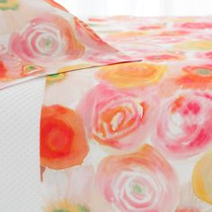 Rest on a bed of beautiful blooms with this sheet set. Inspired by a Parisian watercolor and crafted of crisp cotton, this sheet set evokes a summer sunset in shades of pink, orange, yellow, and green. Create the perfect pairing with other colorful cotton bedding coordinates, like our Boyfriend matelasse coverlets, Marina quilts, and Laundered Linen decorative pillows and throws.