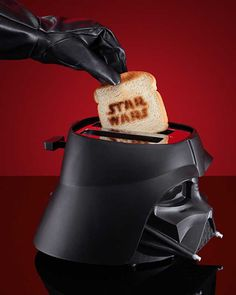 I recently bought a new toaster oven, which I primarily use for re-heating pizza. But if I had the counter space, I might considered getting this Darth Vader helmet that somewhat conceals a toaster. As an added bonus, the Star Wars logo is toasted/burned onto a single side of your bread. This is the perfect way to let the guy who steals your lunch from the office fridge know that you are a Star Wars fan. As far as toasters go, this is on the pricey side at $50, but you can't discount…