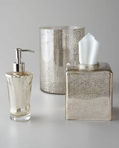 """""""Vizcaya"""" Glass Vanity Accessories, """"Vizcaya"""" Glass Vanity Accessories  Finished to look like mercury glass, these vanity accessories bring vintage-style glamour to your dressing area. Dimensions listed below are approximate. Pump dispenser, 3""""Dia. x 8.25""""T. Tissue box, 5.5""""Sq. x 5.25""""T. Wastebasket, 6.5""""Dia. x 9.5""""T. Vanity tray, 9.5"""" x 5.5""""."""