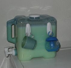 frugally green: How to Make your own Laundry Soap.  I've made the laundry soap.  Now I need to find the dispenser.  I like the use of adhesive hooks to hold the measuring cup.  My front end loader only uses a 1/4 cup.