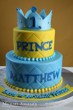 The Prince #5Milestones This two tier cake is iced in fondant and features a stitching pattern on both tiers. The cake is personalized with the birthday prince's name & topped with a gum paste crown.