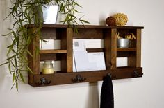 [ D E S C R I P T I O N ] Store your keys, mail, phones, tablets, coats, etc. all in one place with this beautiful wall mounted organizer. The large open center space is perfectly sized for large mail and magazines. This would look great in your entryway, hall, foyer, mudroom, or even in your office. With its sturdy construction, this could also be used as a bathroom shelf with hooks for towels.  -------------------------------------------------- [ F I N I S H / C O L O R ] Light Walnut ...