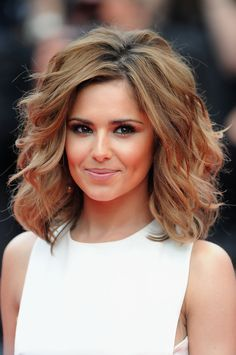 Cheryl Cole Lookbook: Cheryl Cole wearing Short Wavy Cut (26 of 125). The beautiful brunette wore a voluminous, waved hairstyle with honey-hued highlights.