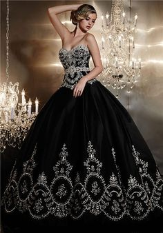 Strapless satin ball gown gown with heavily beaded bodice and sweetheart neckline, beaded belt detail, and embroidery along hemline. Lace-up back and semi-cathedral train.