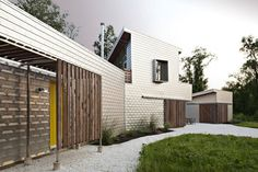 Architecture: Wooden Slatted Screens Fasten Across Glass Doors And Windows To Secure The Aluminium Clad