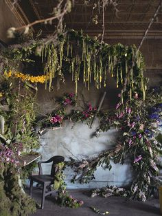 floral installation | Detroit abandoned house filled with thousands of flowers, by Lisa Waud