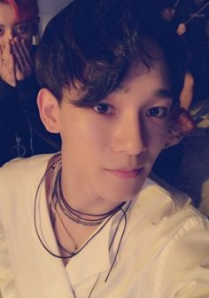 Jongdae with a little channie in the background