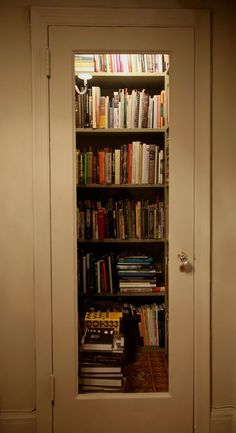 a cool way to make a tiny library of your own. take one small closet, put in shelves and cut out part of the door and put in glass. taa-dah!YES!