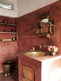 Indian style bathroom. Noticing the mirror/medicine cabinet is a puja shelf.
