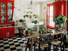 love this kitchen... checkered floor, farmhouse sink, rustic table and chairs, and a red cupboard, too!