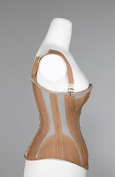 Corset,  Designer: Madame McCabe Date: 1887–90 Culture: American Medium: cotton, metal, bone, elastic Dimensions: Length at CB (a, b): 18 1/2 in. (47 cm) Credit Line: Brooklyn Museum Costume Collection at The Metropolitan Museum of Art, Gift of the Brooklyn Museum, 2009; Gift of E. A. Meister, 1950 Accession Number: 2009.300.2758a–d