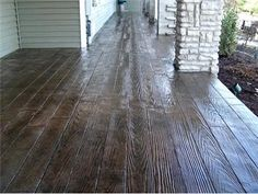 Not wood!  Stamped and stained concrete. I love this!