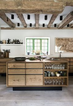 Gray floor, white walls, wood cabinetry. Mint window trim. NOMA OWNER RENÉ REDZEPI'S STUNNING DANISH HOME