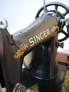 Singer treadle sewing machine.  I made a lot of clothes on one like this for grandma, my mom and me.  Loved it.