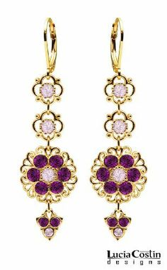 Stunning Dangle Flower Earrings by Lucia Costin Made in 24K Yellow Gold over .925 Sterling Silver with Filigree Ornaments and Lilac, Violet Swarovski Crystals, Crafted with 4 Petal Flowers and Fancy Charms Lucia Costin. $69.00. Update your everyday style with inspiration when wearing this piece of jewelry. Flowers and fancy ornaments beautifully combined. Adorned with light purple and purple Swarovski crystals. Unique jewelry handmade in USA. Irresistible dangle earrings...