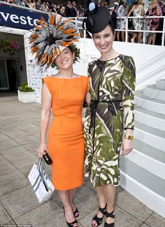 And the award goes to... Leigh Johnson, left, was deemed the best dressed of the day by Harvey Nichols Group Fashion Director Paula Reed, right, so she received the jackpot of £5,000