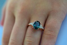 Teal sapphire Rose gold engagement ring. Engagement ring by Eidelprecious. This is Campari design by Eidelprecious. The ring features a 2.33 oval sapphire. The color is gorgeous very deep teal color. The sapphire is very beautiful and clean. This beauty is set in my signature Campari