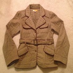 Brown quilted jacket Mushroom colored channel quilted  jacket by Tulle. Piped in brown trim, brass snap buttons with belt. Well loved but lots of life left. One small flaw at hem on back. Fits like a small. Tulle Jackets & Coats Utility Jackets