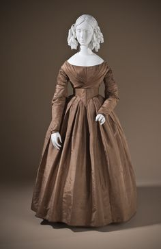 Love love love the brown and the rounded shoulder style of the era. >>Dress: ca. 1845, English (probably), silk taffeta and glazed linen.