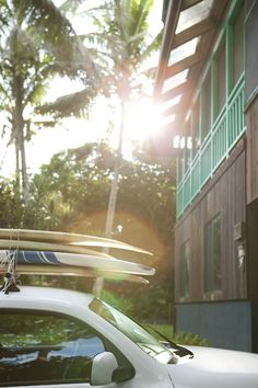 caydiemccumberphotography:  Surf boards on the roof rack and sun in the sky.