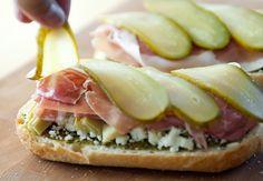 Feta Artichoke Sandwich-                               good bread like a crusty baguette  pesto  feta  canned artichoke hearts, sliced  prosciutto  dill pickle, sliced lengthwise  lettuce  tomato (optional)
