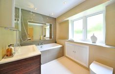 Bathroom remodel with rain faucet tub. click image above to enlarge European Kitchen Cabinets, Refinish Kitchen Cabinets, Bathtub Remodel, Diy Bathroom Remodel, Modern Toilet, Guest Toilet, Cabinet Furniture, Corner Bathtub, Farmhouse Style