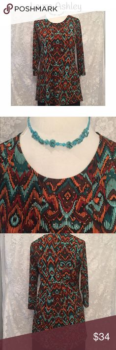 Laura Ashley blouse with rhinestones on the front! Beautiful Laura Ashley blouse in gorgeous colors and a beautiful pattern. Long style blouse looks cute with leggings. Gathered in the. Ask for extra cuteness! Necklace to March available separately! Laura Ashley Tops Blouses