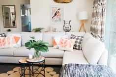 """A [Harvey Norman](http://www.harveynorman.com.au/ target=""""_blank"""" rel=""""nofollow"""") sofa is the hero piece of the second living room, styled up with playful pastel cushions."""