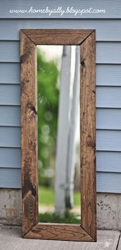 DIY rustic mirror instructions from the blog homebyally.  All she used was a mirror from Walmart, a staple gun, gorrilla glue and pine boards .I love this look.