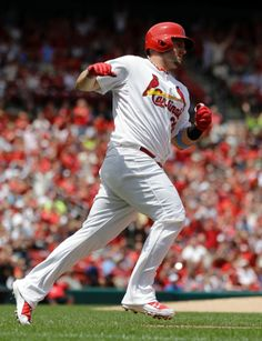 Matt Adams celebrates as he rounds the bases after hitting a two-run home run during the second inning of a baseball game against the Washington Nationals. Adams hit a home run in all 3 games of the series. Cards won 5-2. 6-15-14