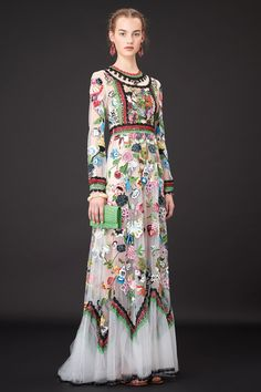 Valentino, Ready-to-wear, Cruise 2015 With artist #FridaKahlo as inspiration the #Valentino #Cruise2015 collection presented floral silhouettes alongside mesmerizing multicolored pieces.  http://voguefr.fr/Valentino2015