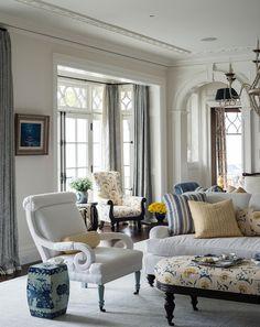 Traditional mouldings & fabulous modern fabrics.. Lovely design....English style sofa....