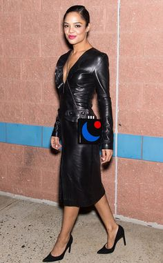 Celebrities In Leather: Tessa Thompson wears a black leather dress