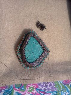 Turquoise pendant on its journey to Linda's friend