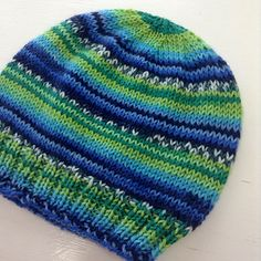 This pattern was written for the Adriafil Knitcol self-striping yarn, but I also included several different yarn weights and gauge options on the second page. If you knit the XS, you'll have enough yarn left over to make a pom pom for your hat.