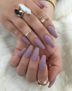 When you've got all the accessories, like rings and bracelets for the bling, sometimes you need to tone it down. It's exactly what's happening in this example. Just some nude matte on coffin nails and everything's ten times better.
