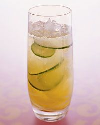 Cucumber Cooler!  (non-alcoholic)  In a cocktail shaker, muddle the pineapple chunks and juice with the Simple Syrup. Add the Cucumber Water and ice; shake well. Pour into a highball glass and top with the soda and cucumber slices.