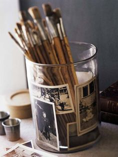 Make a simple one-of-a-kind pencil or paintbrush holder that also displays family photos. Black-and-white snapshots slip between two clear glass flea market apothecary jars for an instant photo gallery. If you can't find apothecary jars, substitute any two graduated sizes of glass containers, such as florist's vases or kitchen glassware. Change out photos when bored!  I have and love!