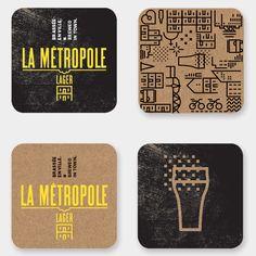 La MétropolePour ce produit local, cette bière blonde, nous avons mis de l'avant les icônes du territoire, dans un assemblage qui oscille entre structure et chaos. Le duplex y est à l'honneur et les couleurs, kraft et le bitume, sont très urbaines. Ce p…