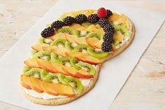 Please the whole crowd with our Flip Flop Fruit Pizza recipe! This fruit pizza is shaped like some of our favorite summer footwear.