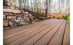 Trex deck boards in Transcend Spiced Rum with Vintage Lantern chair rails and charcoal balusters