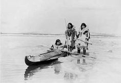 Inuit women with traditional dress and weaponry, preparing to take the photographer's wife on a hunting expedition. Roughly circa 1912. Library of Congress Prints and Photographs, Photograph by Frank E. Kleinschmidt.