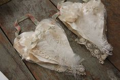 Coffee filters, sewing patterns and tulle, topped with lace and flowers