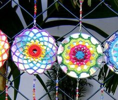 They are upcycled CDs that have colorful mandalas over them and then are hung in strings. By Cristina Vasconcellos. They are upcycled CDs that have colorful crochet mandalas over them and then are hung in strings. By Cristina Vasconcellos Crochet Home, Crochet Motif, Crochet Crafts, Crochet Flowers, Crochet Projects, Crochet Patterns, Crochet Ornaments, Mandala Crochet, Crochet Ideas