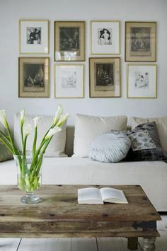 Here is an interesting idea. Two different sets of framed art are blended together in one wall grouping.