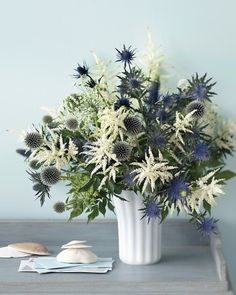 We love this arrangement with a variety of thistles and astilbe that is reminiscent of fireworks