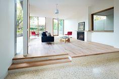 Concrete + wood flooring zones.