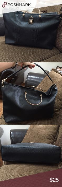 """Just Fabulous Black Reptile Skin Tote Bag This bag has been worn twice max and is like new. There are no signs of wear. Handles are metal and have two rose gold spots on them, which is normal for such metal to turn like that after some time. The approximate measurements are: W 4'', L 17'', H 13"""". It is a big tote and can fit a lot of stuff in it. Very elegant and yet comfortable bag to wear. JustFab Bags Totes"""