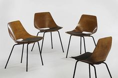 Tonneau Charis. 1954. Pierre Guariche. plywood, vinyl cushions, black enameled legs.